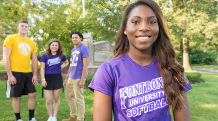 students in front of Fontbonne University sign