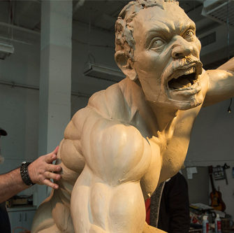"Scott Beaty sculpts ""the Producer."""
