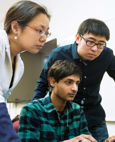 Yi with students in computer lab