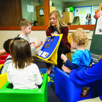 A Fontbonne student works with young clients.