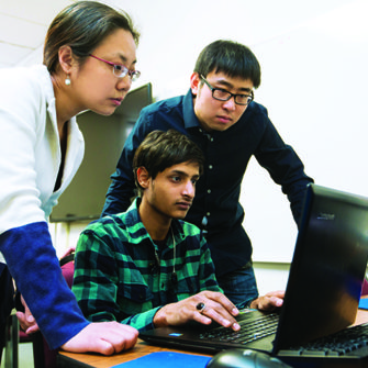 Dr. Yi Yang works with graduate students.
