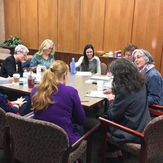 Dr. Susan Lenihan works with Fontbonne graduate students.