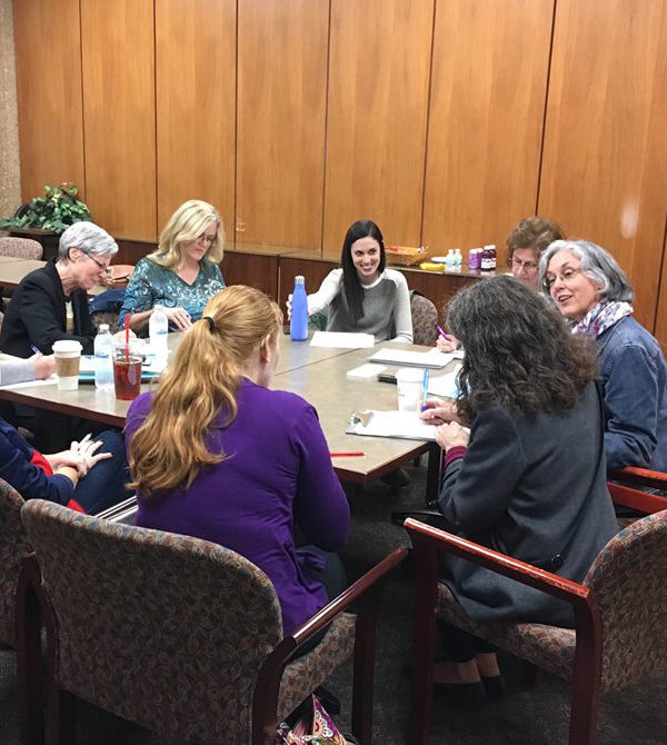 Dr. Lenihan works with students in a roundtable.