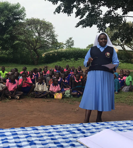 SrHellen teaches a group of students in Gulu, Uganda.
