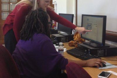 Technology teacher with a student.