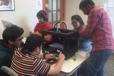 Technology students working in a lab.