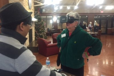 Older lady testing out virtual reality.