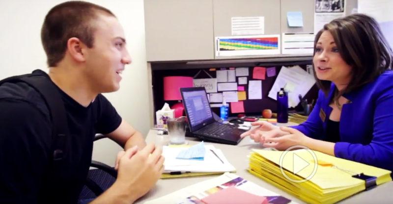 Advisor talking to student.