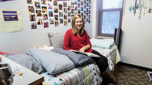 Female student sitting in her apartment.