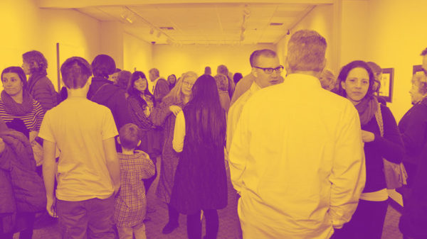 People gathered at an art exhibit.