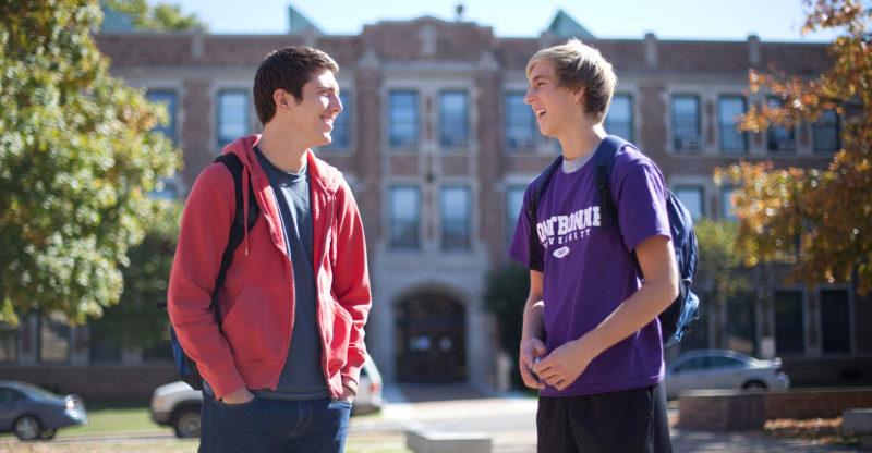 Freshman males talking outside of class.