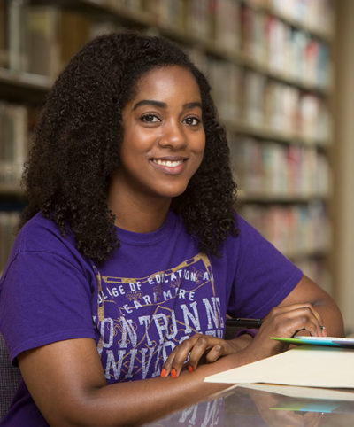 Honors student studying in the library.