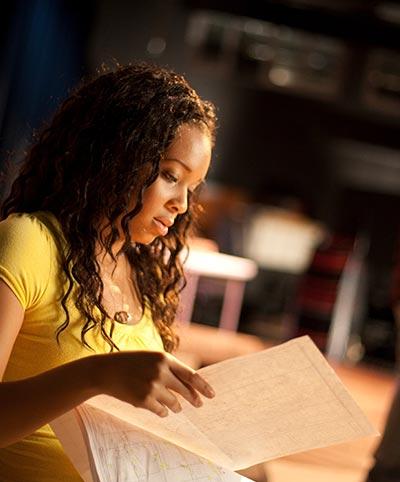 Theatre student reading a script.