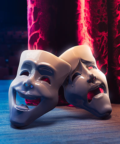 Theater masks on a stage.