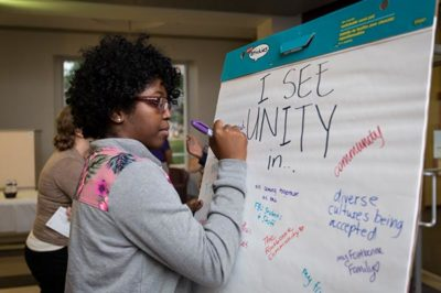 Female student at unity event.