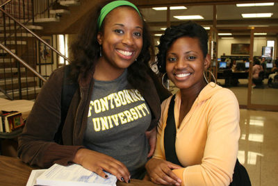 Two female students smiling.