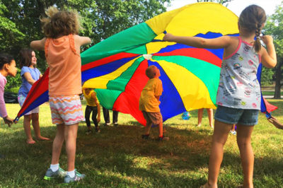 Campers having fun while playing outdoors.